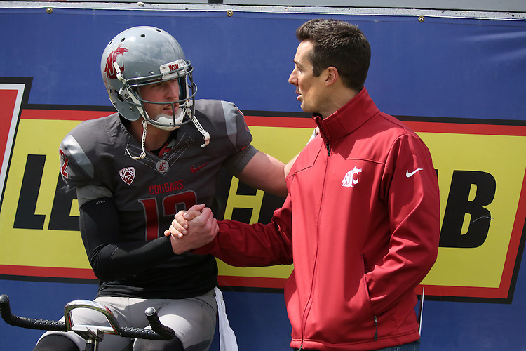Washington State quarterback, Connor Halliday, talks with Cougar Legend and former Cougar quarterback, Jason Gesser, at the annual Washington State Cougar spring game, the Crimson and Gray game, at Joe Albi Stadium in Spokane, Washington, on April 26, 2014.
