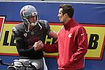 Washington State quarterback, Connor Halliday, talks with Cougar Legend and former Cougar quarterback, Jason Gesser, at the annual Washington State Cougar spring game, the Crimson and Gray game, at Joe Albi Stadium in Spokane, Washington, on April 26, 2014.