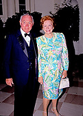 Donald E. Newquist, Chairman, United States International Trade Commission, and guest arrive at the White House in Washington, DC for the State Dinner in honor of President Patricio Aylwin of the Republic of Chile on Wednesday, May 13, 1992.<br />