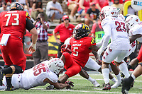 College Park, MD - September 15, 2018: Maryland Terrapins running back Anthony McFarland (5) gets tackled  during the game between Temple and Maryland at  Capital One Field at Maryland Stadium in College Park, MD.  (Photo by Elliott Brown/Media Images International)