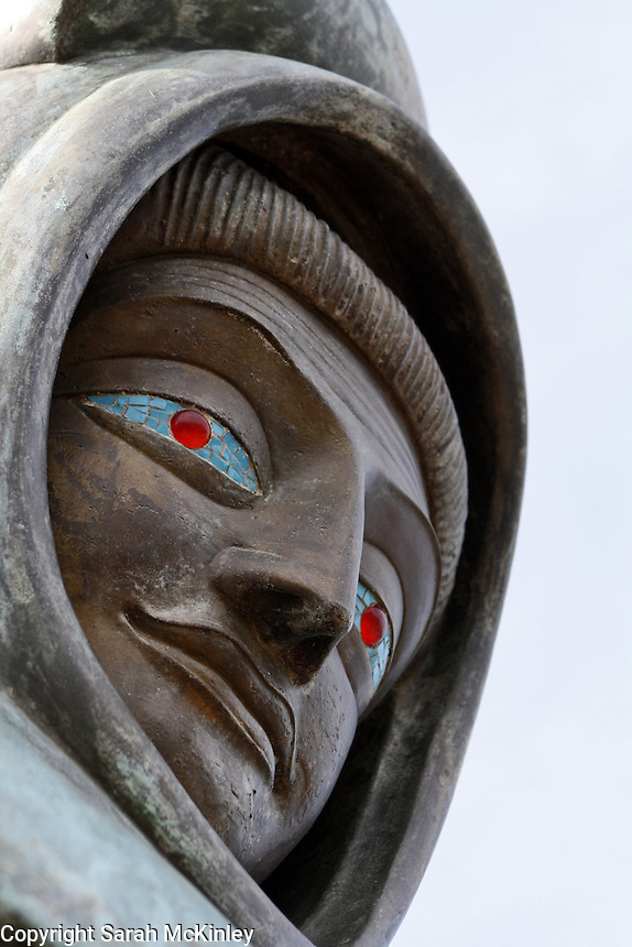The red glass and blue mosaic eyes of the St. Francis statue at Mondavi Vineyard near Napa in Napa County in Northern California.