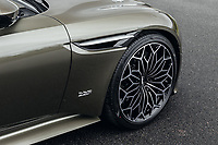 "BNPS.co.uk (01202 558833)<br /> Pic: SilverstoneAuctions/BNPS<br /> <br /> Massive 21"" OHMSS wheels.<br /> <br /> Stunning Aston Martin 'James Bond' supercar with only 45 miles on the clock - yours for £300,000.<br /> <br /> A limited edition Aston Martin that was built to mark the 50th anniversary of one of the most popular James Bond movies has emerged for sale for around £300,000.<br /> <br /> The DBS Superleggera was one of just 50 created last year to commemorate five decades since the release of On Her Majesty's Secret Service.<br /> <br /> The movie, which came out in 1969, was the first in the franchise not to feature Sean Connery and instead starred George Lazenby as 007."