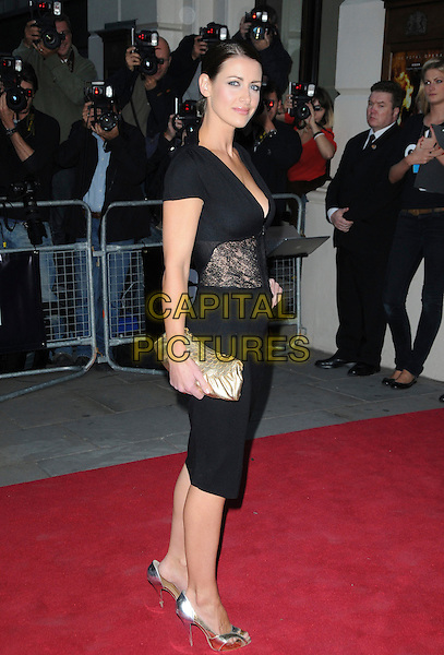KIRSTY GALLACHER .Attending the GQ Men of the Year Awards at the Royal Opera House, Covent Garden, London, England,.2nd September 2008..arrivals full length black dress lace sheer waist panel clutch bag gold shoes heels side .CAP/CAS.©Bob Cass/Capital Pictures