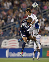New England Revolution defender Darrius Barnes (25) and San Jose Earthquakes forward Chris Wondolowski (8) battle for head ball. In a Major League Soccer (MLS) match, the San Jose Earthquakes defeated the New England Revolution, 2-1, at Gillette Stadium on October 8, 2011.