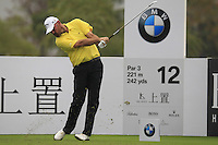 Thomas Bjorn (DEN) tees off the 12th tee during Friday's Round 2 of the 2014 BMW Masters held at Lake Malaren, Shanghai, China 31st October 2014.<br /> Picture: Eoin Clarke www.golffile.ie