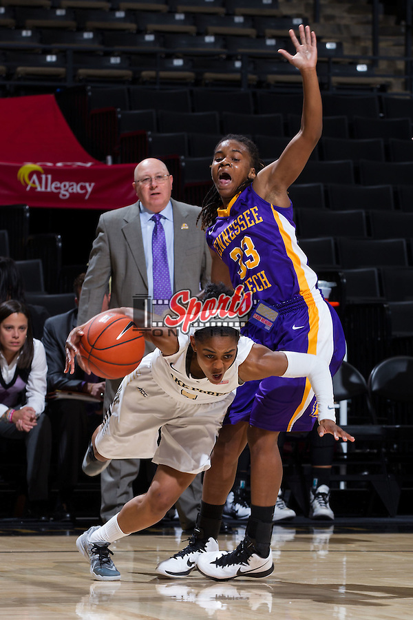 Mykia Jones (4) of the Wake Forest Demon Deacons is fouled by Samaria Howard (33) of the Tennessee Tech Golden Eagles during first half action at the LJVM Coliseum on November 18, 2014 in Winston-Salem, North Carolina.  (Brian Westerholt/Sports On Film)