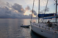 Man on cruising yacht at sunrise