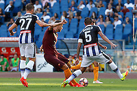 Calcio, Serie A: Roma vs Udinese. Roma, stadio Olimpico, 20 agosto 2016.<br /> Roma&rsquo;s Edin Dzeko, center, is challenged by Udinese&rsquo;s Silvan Widmer, left, and Danilo during the Italian Serie A football match between Roma and Udinese at Rome's Olympic stadium, 20 August 2016. Roma won 4-0.<br /> UPDATE IMAGES PRESS/Riccardo De Luca