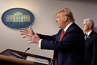 United States President Donald J. Trump speaks during a press briefing on the Coronavirus COVID-19 pandemic with members of the Coronavirus Task Force at the White House in Washington on March 19, 2020.  Pictured at right is US Vice President Mike Pence.<br /> Credit: Yuri Gripas / Pool via CNP/AdMedia
