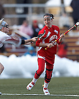 Boston University midfielder Kristen Mogavero (26)..Boston College (white) defeated Boston University (red), 12-9, on the Newton Campus Lacrosse Field at Boston College, on March 20, 2013.