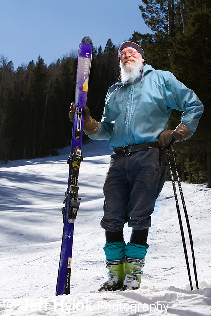 """Igor """"Butch"""" Wood, leader of the summer Pajarito Mountain summer chainsaw crew. You'll never see Butch skiing without his blue jacket and knickers."""