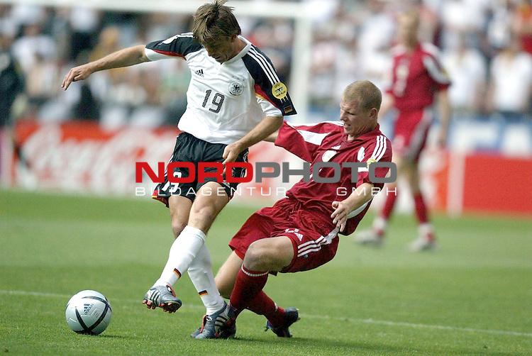 Europameisterschaft 2004 Portugal<br /> <br /> Lettland - Deutschland  0:0<br /> <br /> Bernd Schneider und Andrejs Rubins<br /> <br /> Foto &copy; nordphoto<br /> <br /> <br /> <br /> Gemaess Auflage der UEFA duerfen saemtliche Bilder von der EURO 2004 nicht fuer MMS Dienste oder sonstige Dienste via Mobiltelefon oder mit PDAs genutzt werden.<br /> <br /> <br /> <br /> <br /> <br />  *** Local Caption *** Foto ist honorarpflichtig! zzgl. gesetzl. MwSt.<br /> <br />  Belegexemplar erforderlich<br /> <br /> Adresse: nordphoto<br /> <br /> Georg-Reinke-Strasse 1<br /> <br /> 49377 Vechta<br /> <br /> Telefon: 04441-89400 / Fax: 04441-894022