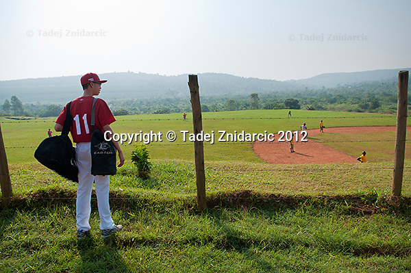 Canadian player Yi An Pan looks at the baseball field in Mpigi, Uganda on January 17 2012.