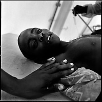 Luanda, Angola, May 21, 2006.Kaka, 7, is a patient at the Cazenga MSF operated cholera field clinic. Between February and June 2006, more than 30000 people were infected with cholera in Angola's worse outbreak ever; more than 1300 died.
