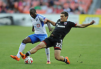 Washington D.C. - May 17, 2014: Chris Korb (22) of D.C. United shields the ball from Sanna Nyassi (11) of Montreal Impact.  D.C. United tied the Montreal Impact 1-1 during a Major League Soccer match for the 2014 season at RFK Stadium.