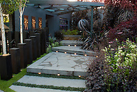 "Beautiful blue tones patio steps with built-in lighting, birch trees, landscaping, arbor, garden ornament in dusk, evening night garden lights. Hidden glows from walls, posts, steps, ""windows""."