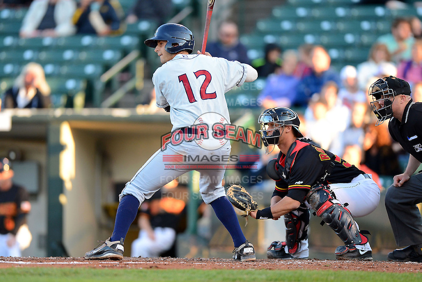 Scranton Wilkes-Barre RailRiders third baseman Dan Fiorito #12 at bat in front of catcher Dan Rohlfing #52 during a game against the Rochester Red Wings on June 19, 2013 at Frontier Field in Rochester, New York.  Scranton defeated Rochester 10-7.  (Mike Janes/Four Seam Images)