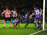 Lincoln City's Shay McCartan scores the opening goal<br /> <br /> Photographer Andrew Vaughan/CameraSport<br /> <br /> The EFL Sky Bet League Two - Lincoln City v Port Vale - Tuesday 1st January 2019 - Sincil Bank - Lincoln<br /> <br /> World Copyright © 2019 CameraSport. All rights reserved. 43 Linden Ave. Countesthorpe. Leicester. England. LE8 5PG - Tel: +44 (0) 116 277 4147 - admin@camerasport.com - www.camerasport.com