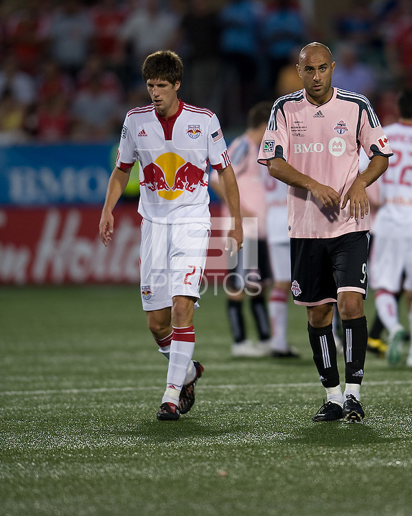 24 June 2009: New York Red Bulls defender Andrew Boyens #27 and Toronto FC forward Danny Dichio #9 take a break during an MLS game between Toronto FC and the New York Red Bulls at BMO Field in Toronto.Toronto FC won 2-0..