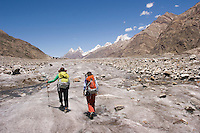 Two women hiking on the Biafo Glacier in the Karakoram Himalya in Pakistan