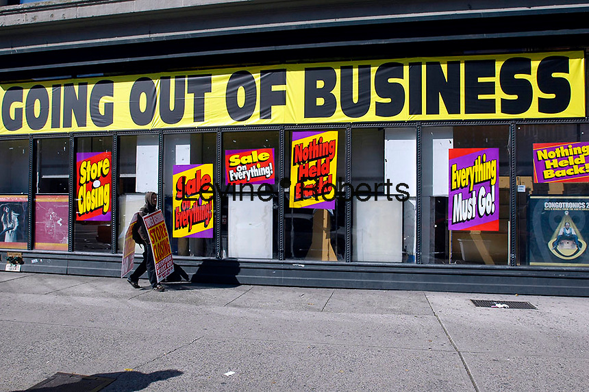 A man wearing a sandwich board advertises the closing in front of the Tower Records and Video store in Manhattan's Greenwich Village on October 22, 2006. The bankrupt retailer's assests were purchased at auction by liquidation firm Great American Group which is selling off the store's inventory and closing down the business. Tower operated 89 stores and was founded in 1960.  (© Richard B. Levine)