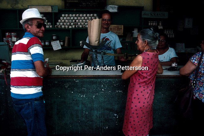 Unidentified locals buying food basics with ration cards on July 7, 1993, in a shop with almost emty shelves in old Havana, Cuba. The economic growth stalled when fuel supplies from the former Sovietunionen stopped after the end of communism. President Fidel Castro has ruled the communist island for over 4 decades and been in war of words with the United States since then. They country has a good education and medical level but lacks freedom of the press and speech. .Photo: Per-Anders Pettersson/ iAfrika Photos