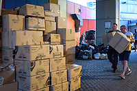 Volunteers carring boxes sorted from hunderds of donations to the victims of the North kensington Grenfell Tower fire, June 14, 2017. The Maxilla Hall Club, under the Westway was one of many centres overwelmed with donations by the public. <br /> CAP/CAM<br /> &copy;Andre Camara/Capital Pictures /MediaPunch ***NORTH AND SOUTH AMERICAS ONLY***