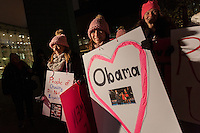 Women wearing pink hats tp protest Trump's pussy grabbing comment hold signs before taking part in a protest march by members of the Democratic Party Abroad organisation to mark the inauguration of President Donald Trump, Tokyo, Japan. Friday January 20th 2017 Around 400 people took apart in the march, which started in Hibiya Park at 6:30pm and finished in Roppongi just before 8pm, to honour the service given by President Obama and to protest against the illiberal policies expected of the new administration of President  Trump.