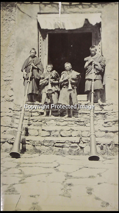 BNPS.co.uk (01202 558833)<br /> Pic: HAldridge/BNPS<br /> <br /> ***Please Use Full Byline***<br /> <br /> Young monks with there temple horns.<br /> <br /> A collection of never-seen-before photographs taken during the controversial 1903 British Mission to Tibet has come to light.<br /> <br /> The rare snaps were taken by an officer during the campaign - the first time the British were given access to the country.<br /> <br /> They depict the haunting beauty of the secluded country and brought images of Tibeten landscapes including Mount Everest to the west for the first time.<br /> <br /> The set contains 140 sepia pictures of Tibetan buildings, people and soldiers, including a particularly poignant photograph of a British gunner manning a Maxim machine gun.<br /> <br /> Early in the campaign, troops gunned down 700 lightly armed Tibetan monks standing in their path in the infamous Massacre of Chumik Shenko.<br /> <br /> The slaughter was so brutal that Lieutenant Arthur Hadow, commander of the Maxim guns detachment, wrote afterwards: &quot;I got so sick of the slaughter that I ceased fire.<br /> <br /> &quot;I hope I shall never again have to shoot down men walking away.&quot;<br /> <br /> The expedition began in December 1903 when around 3,000 troops marched into the country from India led by Colonel Francis Younghusband.<br /> <br /> It was initiated by Lord George Curzon, the Viceroy of India, to prevent Russia gaining influence in Tibet.<br /> <br /> They reach the capital Lhasa in August 1904, when the government signed a treaty effectively turning the country into a British protectorate.<br /> <br /> The photo archive is being sold by desecendents of one of the officers on the trip from southern England after languishing in a drawer for years.<br /> <br /> The collection is tipped to fetch 1,200 pounds when it goes under the hammer.