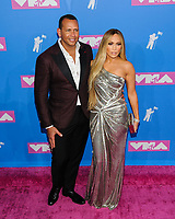 09 March 2018 - Music icon Jennifer Lopez and retired baseball star Alex Rodriguez are engaged after two years of dating. The couple then made their red carpet debut at the Met Gala in May 2017  and have inseparable since. 20 August 2017 - New York, New York - Alexander Rodriguez, Jennifer Lopez. 2018 MTV Video Music Awards at Radio City Music Hall. Photo Credit: Mario Santoro/AdMedia