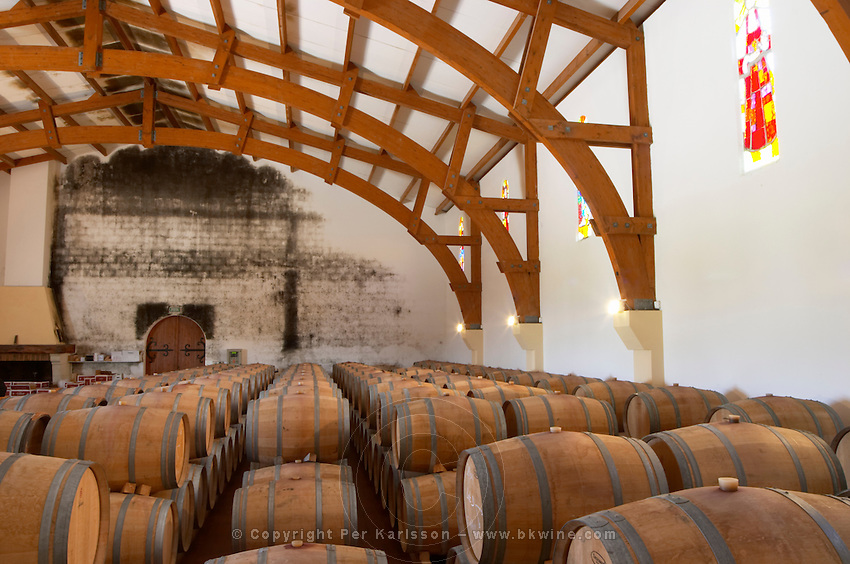 Oak barrel aging and fermentation cellar. Chateau Gaillard, Saint Emilion, Bordeaux, France