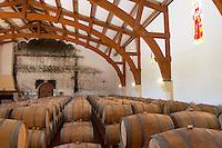 Oak barrel aging and fermentation cellar. Chateau Gaillard, Saint Emilion, Bordeaux, France