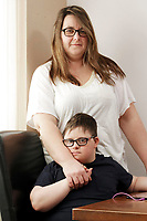 Pictured: Victoria Baynham with son Alex Jones. Friday 02 February 2018<br /> Re: 12 year old Alex Jones, who has Down's Syndrome, was not dropped off home by bus company CJ Contract Travel Services but instead was discovered at the company's depot in Barry, south Wales, on his way back from Ysgol Y Deri School in nearby Penarth.