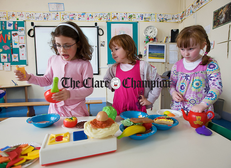 "Aoibheann Madden, Leah Crilly and Edel Cusack making ""lunch""  at Feakle National School. Photograph by John Kelly."