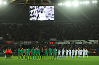 Players from both sides observe a minutes applause in memory of former Swansea City player Kevin Austin<br /> <br /> Photographer Kevin Barnes/CameraSport<br /> <br /> The EFL Sky Bet Championship - Swansea City v West Bromwich Albion - Wednesday 28th November 2018 - Liberty Stadium - Swansea<br /> <br /> World Copyright © 2018 CameraSport. All rights reserved. 43 Linden Ave. Countesthorpe. Leicester. England. LE8 5PG - Tel: +44 (0) 116 277 4147 - admin@camerasport.com - www.camerasport.com