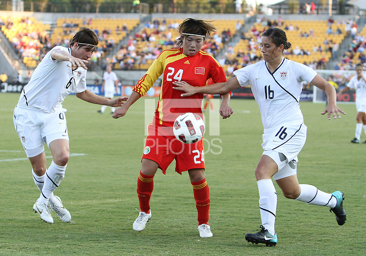 Amy LePeilbet #6 and Ali Krieger #16 of the USA WNT block Yasha Gu #24 of the PRC WNT during an international friendly match at KSU Soccer Stadium, on October 2 2010 in Kennesaw, Georgia. USA won 2-1.