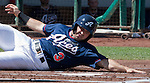 Reno Aces Adam Eaton slides home to score a run in the first inning against the Tucson Padres in their game played on Monday afternoon, September 3, 2012 in Reno, Nevada.