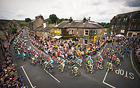Picture by Allan McKenzie/SWpix.com - 06/07/2014 - Cycling - Tour de France 2014 - Stage 2, York to Sheffield - Yorkshire, England - The peloton Passes through Addingham for the second time in Le Tour. COPYRIGHT WARNING : THIS IMAGE IS RIGHTS MANAGED AND THE COPYRIGHT MAY SIT WITH A THIRD PARTY PLEASE CONTACT simon@swpix.com BEFORE DOWNLOAD AND OR USE