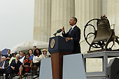 US President Barack Obama (R) delivers remarks in front of a freedom bell during the 'Let Freedom Ring' commemoration event, as (back L to R); former US President Jimmy Carter, former US President Bill Clinton, First Lady Michelle Obama and Oprah Winfrey look on, at the Lincoln Memorial in Washington DC, USA, 28 August 2013. The event was held to commemorate the 50th anniversary of the 28 August 1963 March on Washington led by the late Dr. Martin Luther King Jr., where he famously gave his 'I Have a Dream' speech.<br /> Credit: Michael Reynolds / Pool via CNP