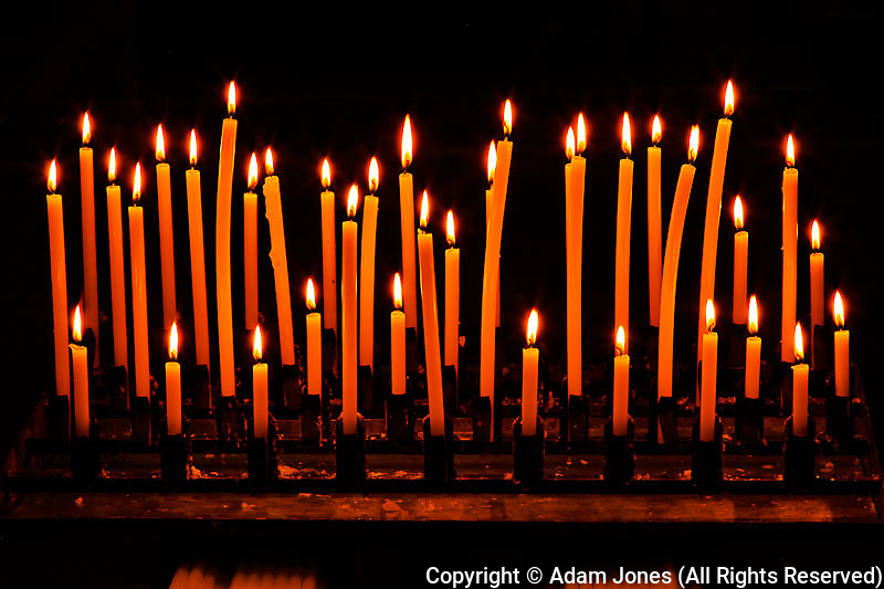 Candles in interior of Oratorio di San Giovanni church in Montepulciano, Tuscany, Italy.