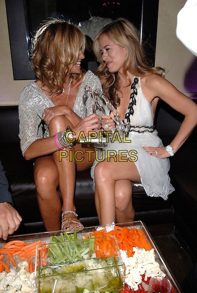 ELLE MacPHERSON & JADE JAGGER.The Grazia O2 Awards at The Paper Club, London, England..June 27th, 2006.Ref: FIN.full length sitting silver white dress watch bracelets awards trophies profile.www.capitalpictures.com.sales@capitalpictures.com.© Capital Pictures.