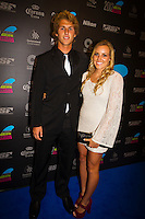 GOLD COAST, Queensland/Australia (Friday, February 24, 2012) Jesse Mendes (BRA) with Sage Erickson (USA).  The 29th Annual ASP World Surfing Awards went off tonight at the Gold Coast Convention and Exhibition Centre with the worlds best surfers trading the beachwear for formal attire as the 2011 ASP World Champions were officially crowned.. .Kelly Slater (USA), 40, and Carissa Moore (HAW), 19, took top honours for the evening, collecting the ASP World Title and ASP Womens World Title respectively.. .I have actually been on tour longer than some of my fellow competitors have been alive, Slater said. All joking aside, its truly humbling to be up here and honoured in front of such an incredible collection of surfers. I want to thank everyone in the room for pushing me to where I am...In addition to honouring the 2011 ASP World Champions, the ASP World Surfing Awards included new accolades voted on by the fans and the surfers themselves...For the first time in several years, ASP Life Membership was awarded to Hawaiian legend and icon of high-performance surfing, Larry Bertlemann (HAW), 56...Where surfing is today is where I dreamed it should be in the 70s, Bertlemann said. You guys absolutely deserve this and Im so honored to be up here in front of you all tonight..Grammy Award-winning artists Wolfmother and The Vernons rounded out the nights entertainment which was all streamed LIVE around the world on YouTube.com..Photo: joliphotos.com
