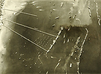 """BNPS.co.uk (01202 558833)<br /> Pic: MitchellsAuctionHouse/BNPS<br /> <br /> PICTURED: Aerial view of Mulberry harbour """"B"""" at Arromanches, Normandy<br /> <br /> The fascinating archive of one of the engineers who designed the Mulberry Harbours which were installed off the Normandy coast following the D-Day landings has come to light.<br /> <br /> Colonel Vassal Charles Steer-Webster OBE helped create the giant, floating artificial harbours which protected anchored supply ships from German attacks.<br /> <br /> They were built in the dry docks on The Thames and Clyde and pulled across the channel by tugs before being hastily assembled.<br /> <br /> Col Steer-Webster was in almost daily contact with Churchill during their development ahead of June 6, 1944. Now, his personal effects, including a letter of thanks from Winston Churchill, are being sold by his nephew with Mitchells Auctioneers, of Cockermouth, Cumbria. <br /> <br /> The archive, which is expected to fetch £15,000, also features 150 photos showing Mulberry B's construction and use, as well as his medals."""