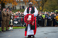 Pictured: The Archbishop of York, Dr John Sentamu carries a wreath. Sunday 11 November 2018<br /> Re: Commemoration for the 100 years since the end of the First World War on Remembrance Sunday at York Minster, England, UK