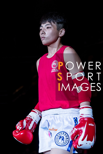 Au Yin Yin Winnie (Red) of Hong Kong enters to the ring  prior the female muay 51KG division weight bout against Molomjamts Erdenetuya (Not in picture) of Mongolia during the East Asian Muaythai Championships 2017 at the Queen Elizabeth Stadium on 11 August 2017, in Hong Kong, China. Photo by Yu Chun Christopher Wong / Power Sport Images