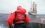 U.S. Coast Guard crew member Nicci Stipech, 24, from Palmdale, Calif. looks of the bow of a Coast Guard motor surf boat at the U.S.S. Coast Guard Eagle training vessel, August 11, 1999 on the Pacific waters along the coast of San Diego during a training excersise. The Eagle a three-masted sailing Barque with 21,350 square feet of sail is home to Coast Guard Academy Cadets for a week the summer prior to attending the Academy. (AP Photo/ Victoria Arocho)