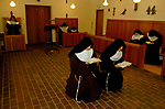 CLOSED ORDER, ROMAN CATHOLIC NUNS, POOR CLARES, HERTS, 1989. No visitors are allowed, they live a silent life of prayer. In the chapel Vespers, a sunset evening prayer service.