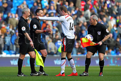 22.03.2014  Cardiff, Wales. Jordan Henderson of Liverpool has a disagreement with the referee during the Premier League game between Cardiff City and Liverpool from Cardiff City Stadium.