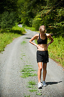 Female athlete stretching after a run