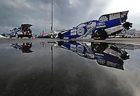 Sept. 1, 2012; Clermont, IN, USA: The car of NHRA funny car driver Robert Hight reflects in a puddle as it is towed back to the pits during qualifying for the US Nationals at Lucas Oil Raceway. Mandatory Credit: Mark J. Rebilas-